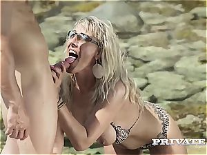 experienced blondie cougar takes what she wants on the sunny beach
