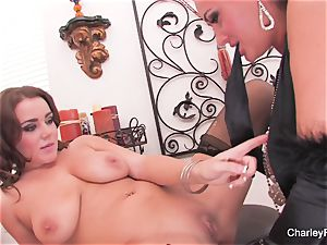 Charley and Natasha play with a dual faux-cock