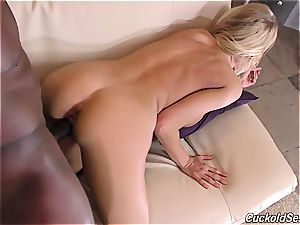 She penetrates a fat ebony guy while her husband watches