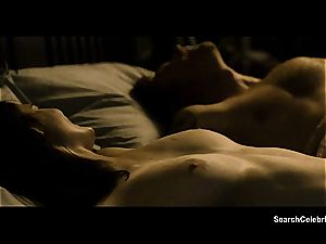 black haired Eva Green has good udders for you to see