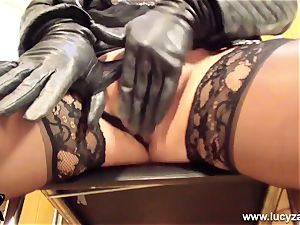towheaded cougar Lucy Zara in all leather fucktoys her wet labia