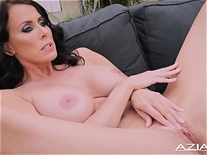 marvelous cougar Reagan Fox thumbs her raw labia outdoors