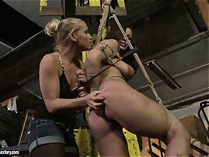 Kathia Nobili smacking the donk of torrid lady with whip