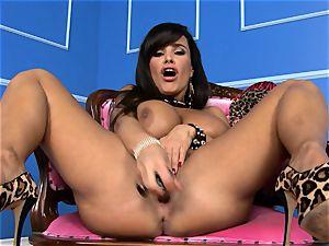 fabulous Lisa Ann sticks her fake penis deep in her moist coochie