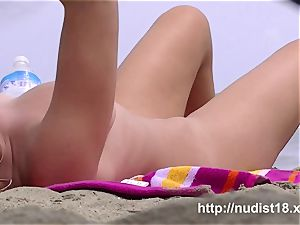 warm ladies get nude on the beach for the spy web cam