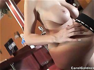 Carol Goldnerova behind the bar