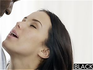 Megan Rain pulverizing a black bone
