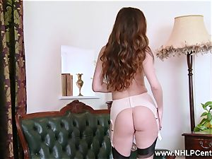 stunner peels off to nylons heels to toy her vagina