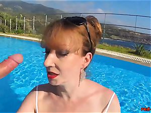 british Mature red hard-core sucking meatpipe in a pool