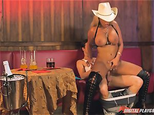 Bridgette B in super-fucking-hot leather boots and penetrates on a couch